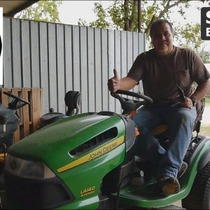 Inspecting a John Deere Lawn Tractor at the Open My World Therapeutic Riding Center